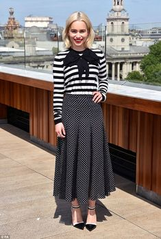 Game of Robes! Game Of Thrones star Emilia teamed her pleated polka dot skirt with a clashing striped long sleeved top