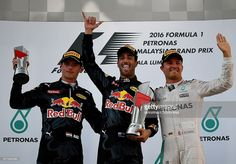Second-placed Red Bull Racings Belgian-Dutch driver Max Verstappen (L), champion Red Bull Racings Australian driver Daniel Ricciardo (C) and third-placed Mercedes AMG Petronas F1 Teams German driver Nico Rosberg (R) celebrate on the podium during the Formula One Malaysian Grand Prix in Sepang on October 2, 2016. / AFP / MANAN