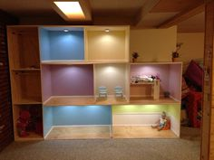Doll house with side storage area that we built four our friend's two daughters