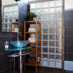 Glass brick tile wall with glass basin and rectangular mirror