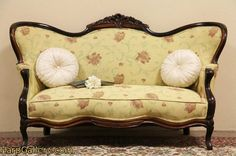 Carved Rosewood Antique Victorian Settee Loveseat, 1860's.  A beautiful shape!  Upholstery is not original, but I like it.