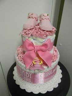 This is a precious BABY GIRL 2 tier diaper cake already loaded, you will receive it ready wrapped in tulle with coordinate curling ribbon, it can