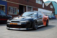 Nissan Silvia, black and orange drift works drift car
