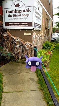Turns out we have a pokestop at the co-op headquarters.  Shellder popped up!