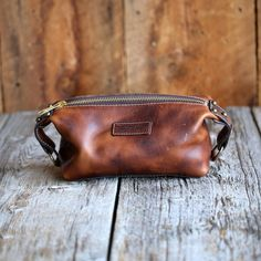 The classic men's toiletry bag is taken to a whole new level with the Boone Dopp. Made from rich, vegetable tanned Dublin leather from the Horween Leather Company in Chicago, The Boone Dopp is an indi