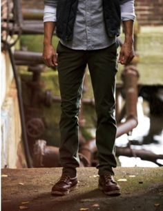 Shop this look on Lookastic:  http://lookastic.com/men/looks/olive-chinos-and-dark-brown-boots-and-grey-longsleeve-shirt-and-charcoal-waistcoat/81  — Olive Chinos  — Dark Brown Leather Boots  — Grey Chambray Long Sleeve Shirt  — Charcoal Waistcoat