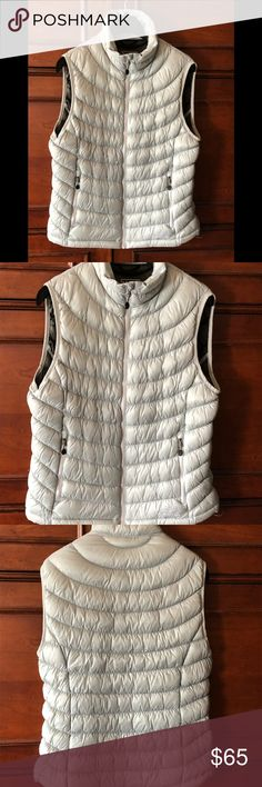 """LL Bean Down Puffer Vest. Small This classic LL Bean puffer vest in a silver blue-grey will keep you cozy at any outdoor activity. In the mountains, hiking the trails or sipping Chardonnay on the Polo Pitch or out on The Links you will look stylish in this down vest! Interior zippered best pocket 14"""" width at top 18"""" width at chest LL Bean Jackets & Coats Vests"""