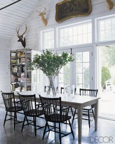 I would open up the dining room with the upper windows..and love how the slats on the wall can look updated when painted bright white.