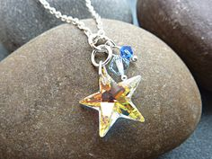 Swarovski Star Necklace with a sparkly yellow Swarovski (aurora borealis) crystal star and blue Swarovski crystal beads. This is a very