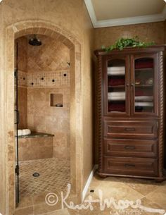 Custom Bath Cabinets By Kent Moore Cabinets.  Dark Maple Wood with Burnt Sienna with Ebony Glaze Finish