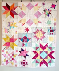 """Michonne's quilt:  This lovely star quilt was made by That Stash Bee as a sort of """"baby shower"""" gift for Michonne/Watch Meesh Run, all thanks to the planning and final execution by Toni/HoosierToni. I can't remember for sure, but I think we were all to make any star block using the designated palette."""
