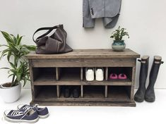 A storage rack for shoes Solid spruce shelf unit for keeping your shoes tidy in the hallway. The lid lifts up to reveal a compartment for hats, gloves and accessories. When closed, the shoe rack is the perfect height to sit on while you tie your laces. L x W x H: 100 x 35 x 49cm