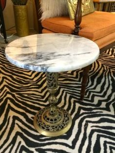 """Pretty Little Marble Top Brass Base Side Table   32"""" High x 16"""" Diameter  $78  Eclectic Treasures Booth #8279  Lula B's  1010 N. Riverfront Blvd. Dallas, TX 75207  Like us on Facebook: ht"""