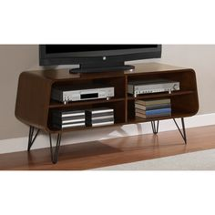 This retro media center design will add style and pizazz to your home décor.  The unique design will provide plenty of storage for your media needs.