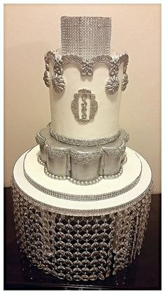 Cake by Kaya's Kreations using our Floral Border, Floral Swag, Angie lace, Glimmer & Grand Tassel Drop molds.