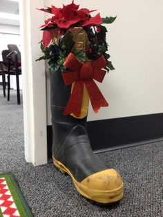 Fire Department Christmas Decorating: Fireman boots with poinsettias
