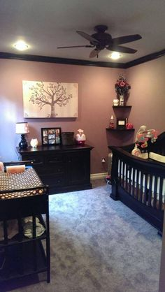 love that this room is different- dark furniture for baby instead of light, and dark moldings
