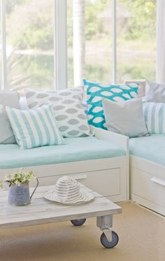 Beach chic modern turquoise white grey decor with turquoise and white throw pillows by Coastal Interior Decor, includes Premier Prints fabric. I'm digging that bright teal/turquoise pillow in the back. I feel a diy project coming on!!