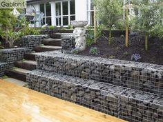 "stepped gabion wall 18"" tall x 18"" thick, and railway sleeper steps http://www.gabion1.com"