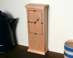 This handmade wall clock is made from maple and has walnut inlay. It was made by David Towers cabinet-maker and is designed so that it can stand or be wall mounted with a pendulum. www.davidtowers.biz