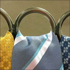 This Ringed Table Stand For Mara Neckties allows quick draping of merchandise, and comparison of patterns and colors from a distance Neckties, Hooks, Retail, Tote Bag, Rings, Table, Color, Ring, Colour