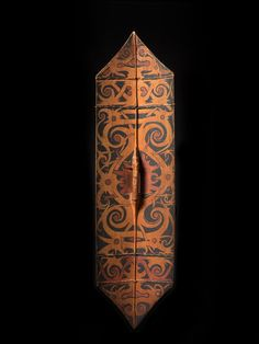 Shield 10247 Shield 10247 Shield 10247 Shield 10247  Warrior's Shield, Klau or Kliau 10247  Dayak, Borneo  Wood, pigment, human hair  19th/very early 20th Century  51.5 in/131 cm  $9500  Shields of this style are most often associated with the Kayan-Kenyah cultural complex, though other Dayak tribes display similar fanged protector deities, known as Kambe or Udog. They are made from a light hard wood, jelutong, painted with natural resins and decorated with scalp hair from the trophy heads…