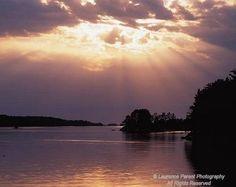 Minnesota, Voyagers National Park Kabertogama Lake, sun rays over the lake
