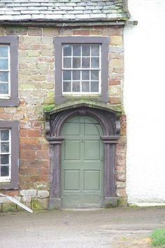 Old door of the old farmhouse at Bowness House Farm, UK