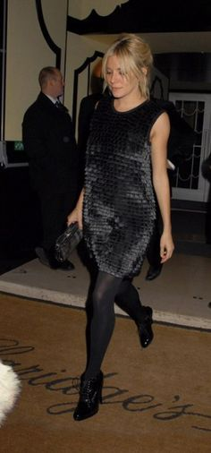 Sienna Miller wearing Burberry Patent Leather Ankle Boots, Burberry Dress and Burberry Medieval Clutch Bag.