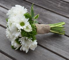 Petit bouquet with white ranunculus, mums, white tulips and dianthus.