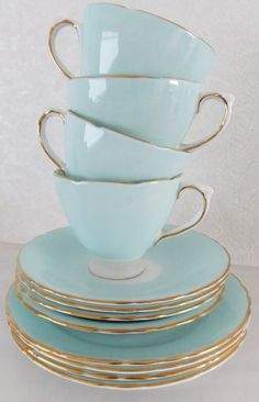 Blue tea cups and saucers with gold trim