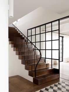 Those chunky stairs and that railing would work well in our house. I like those glass panes as a way to retain the support wall but open up the space. by Gratsiela Staircase Railings, Banisters, Staircase Design, Stairways, Farmhouse Stairs, Farmhouse Ideas, Wooden Stairs, Wooden Beam, Interior Stairs