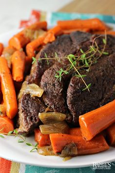 Dutch Oven Pot Roast by Renee's Kitchen Adventures is an easy recipe for oven braised pot roast with carrots and onions that comes out fork tender! Angus Beef Roast Recipe, Roast Recipe Dutch Oven, Chuck Roast Recipe Oven, Oven Roast Beef, Chuck Roast Recipes, Sirloin Tip Roast, Beef Chuck Roast, Pot Roast Recipes, Onion Recipes
