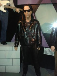 from wearing a black leather jacket and his wax statue. Wax Statue, U 2, Black Leather, Leather Jacket, Shades, Celebrities, Music, How To Wear, Jackets