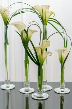 Grasses with flowers in vases. May need to cut up grasses into smaller strands.