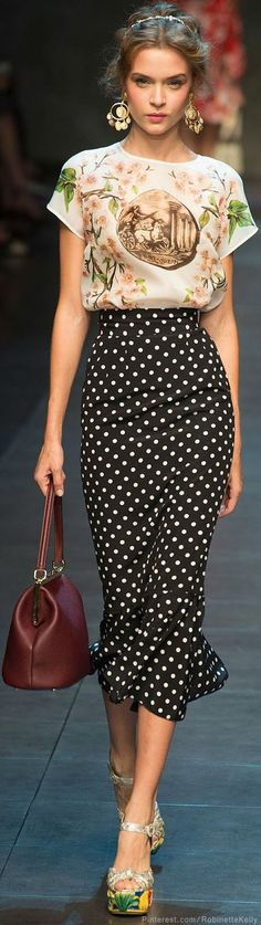 Black polka dot trumpet midi skirt, white oriental pattern top, white pattern heels