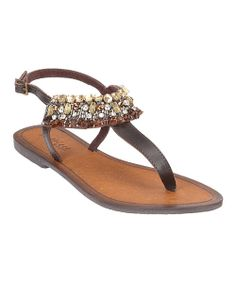 Sweet and simple meets gorgeous glam in this sunny weather sandal. An elegantly embellished strap adds fabulous flair to a cleanly styled shoe