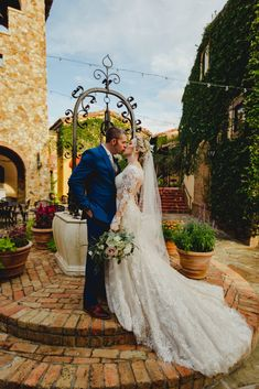 Our beautiful White Closet bride Rachel saying I do in jaw dropping Justin Alexander style 88010 fit and flare lace gown with an illusion bodice with long sleeves. White Closet, Bridal Boutique, Designer Collection, Fit And Flare, Illusions, Bodice, Brides, Gowns, Wedding Dresses