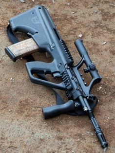 "Austrian Steyr AUG, 5.56x45mm. The first really successful ""bull pup"" assault rifle."