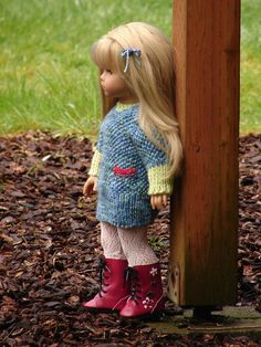 """'Anyah'by Debonair Designs. ~ a textured stitched sweater dress complete with incorporated pockets knitting pattern designed for 18"""" American Girl dolls. printed knitting pattern to knit your own sweater dress, NOT for purchasing a finished outfit. 