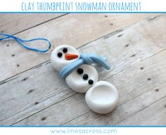 Clay thumbprint snowman ornament....convenient that there will be 3 sets of thumbs to take prints from next winter
