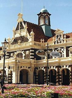Nicknamed 'Gingerbread George' the Dunedin Railway Station, South Island, New Zealand. Construction began in 1903 and it opened in 1906.  It was designed by George Troup.