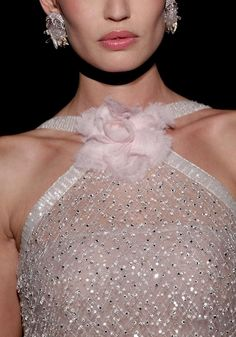 Chanel haute couture. Love the dress. Not crazy about the flower.