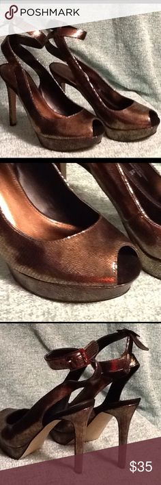 Metallic Dress Heels Brand new in original box. Made by Marc Fisher and have the style name of Verna2. They are bronze peep toe heels. The heel is 5 inches. Synthetic  upper and sole. Marc Fisher Shoes Heels