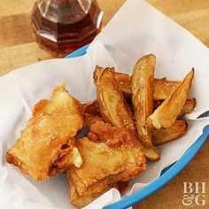 Enjoy a taste of the UK with this classic fried fish and chips recipe. Sprinkle on malt vinegar and dunk in tartar sauce for the most authentic battered fish experience.
