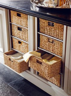 Basket drawers for where the dishwasher used to be.. good idea,  Id rather wash dishes by Hand than Use a dishwasher