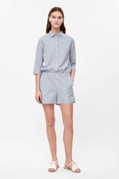 This shirt inspired jumpsuit is made from a soft cotton with an all-over stripe pattern. A relaxed fit and a short style, it has a neat collar, sleeves and subtle side seam pockets. Playsuits, Jumpsuits, Striped Jumpsuit, Lounge Wear, Nice Dresses, Stripe Pattern, Rompers, Shirt Dress, My Style