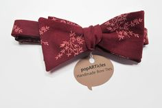 This freestyle, self-tie bow tie is made with 100% cotton in a wine or burgundy and tan floral calico print. This burgundy bow tie is the perfect fall accessory.  The neckband is adjustable from 15 to 18.  *Multiples are available. Please send me a message.*  Dry clean only. Iron with a little steam when needed.  This, and all items I sell, are handmade. Thanks for supporting handmade!  Check out my other bow ties…
