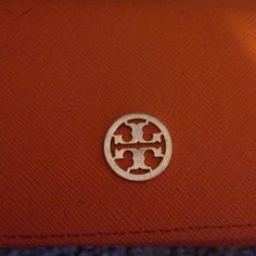 Tory burch clutch Used, some pen stains on inside and out but overalls pretty good condition Tory Burch Bags Clutches & Wristlets
