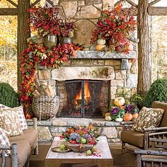 Cozy Outdoor Fireplace | Create a festive retreat for guests with lots of plush seating and a mantel swathed in a foliage garland made from a combination of oak and magnolia leaves.